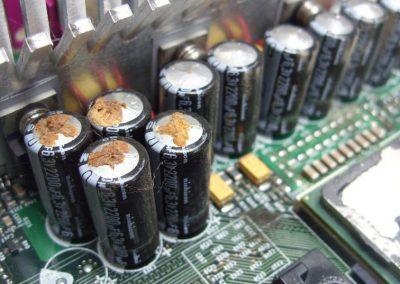 swollen_leaking_capacitors_motherboard
